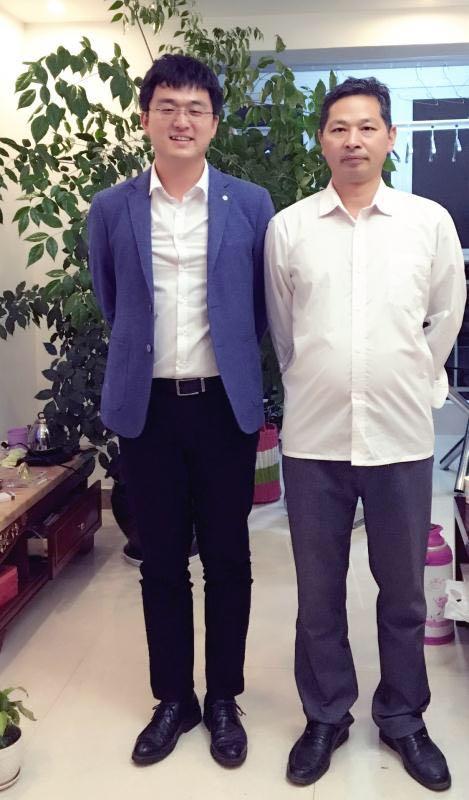 黄云龙律师与昆明理工大学法学院院长助理魏汉涛教授合影